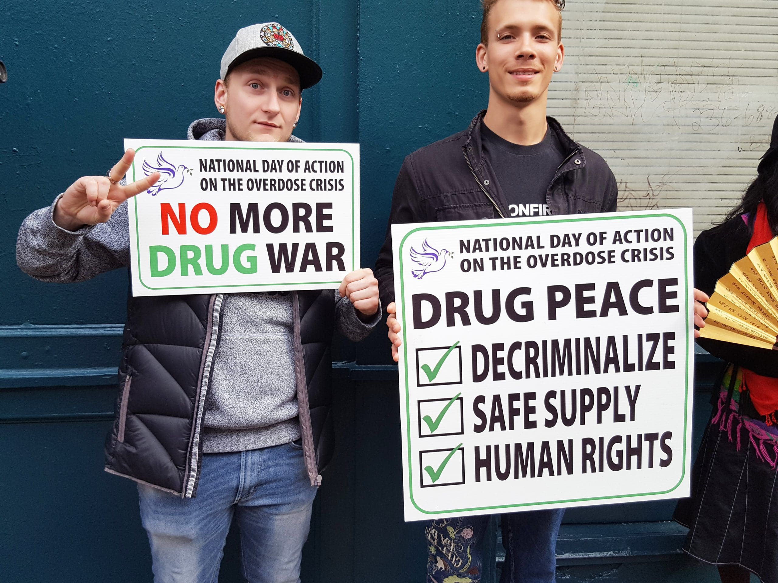 Two men holding signs