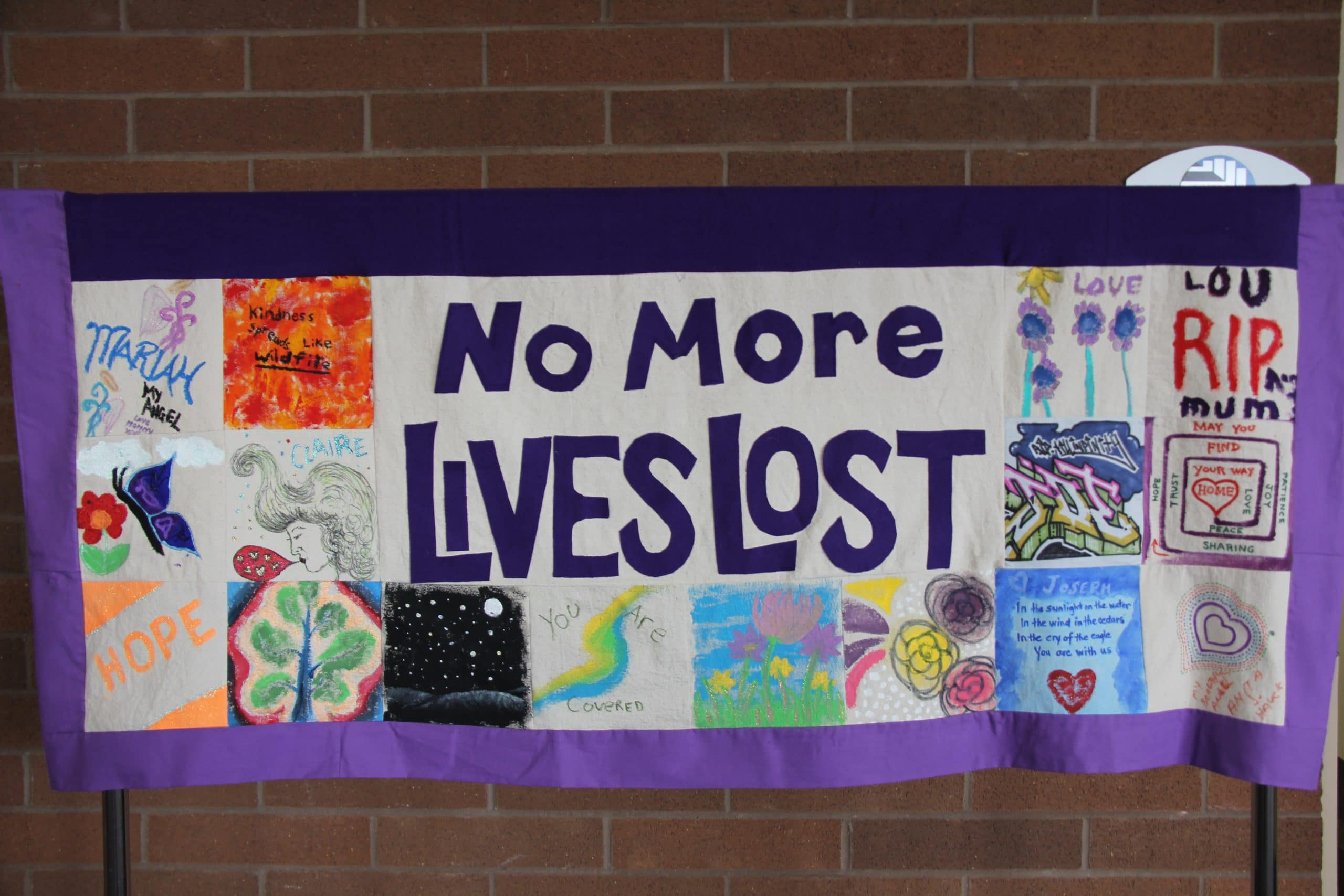 "Quilted banner reading ""no more lives lost"""