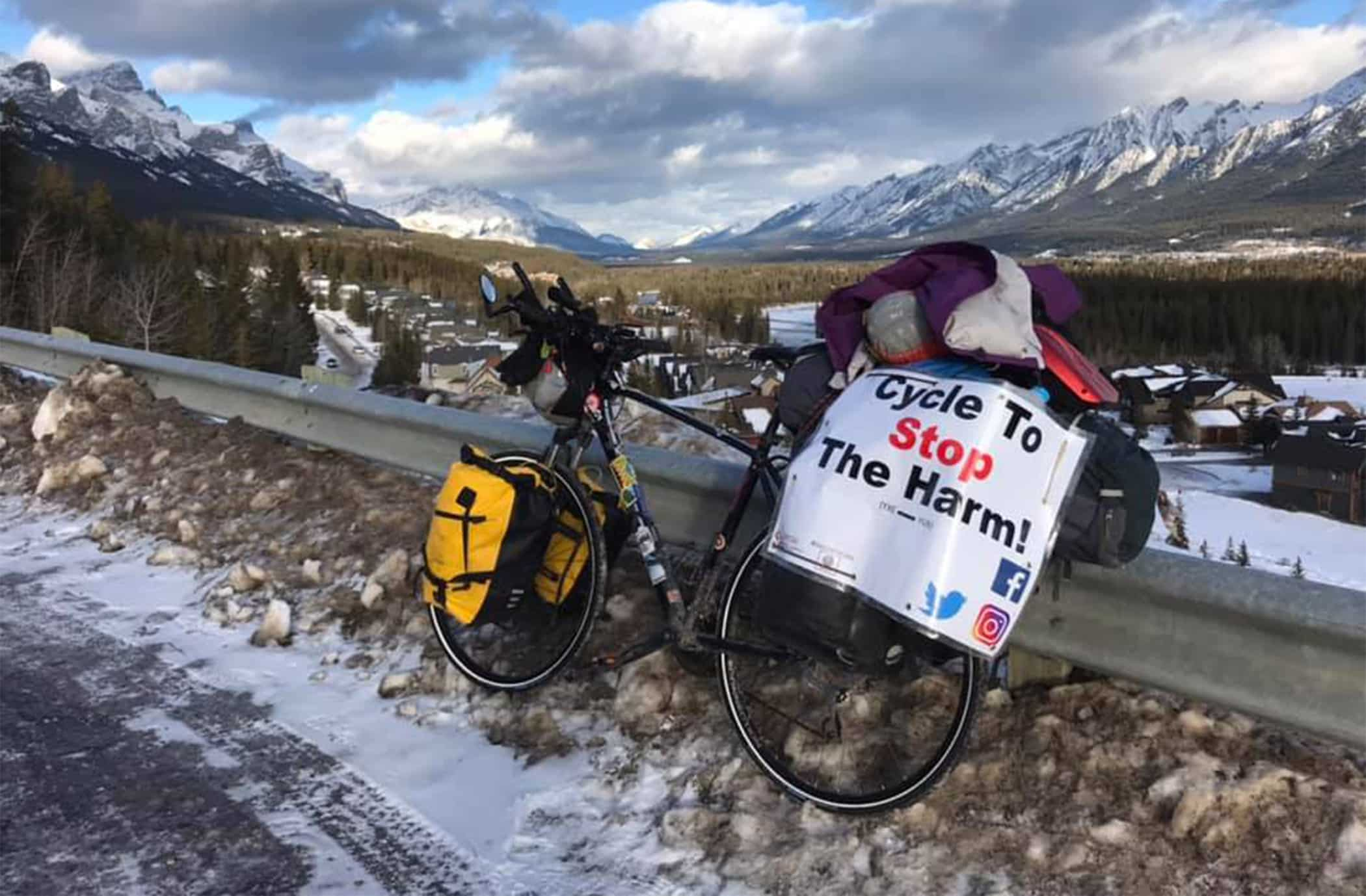 Bike leaning on a railing along a mountain highway pass | Iliajah Pidskalny cycle