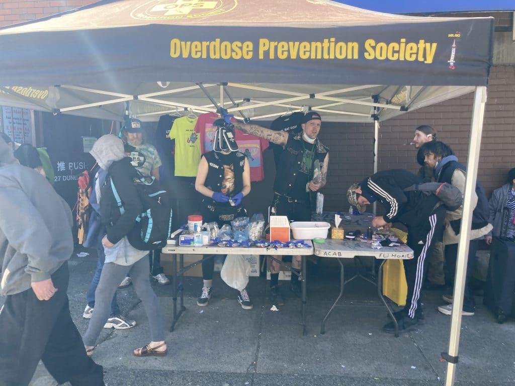 Overdose response volunteers under an event tent