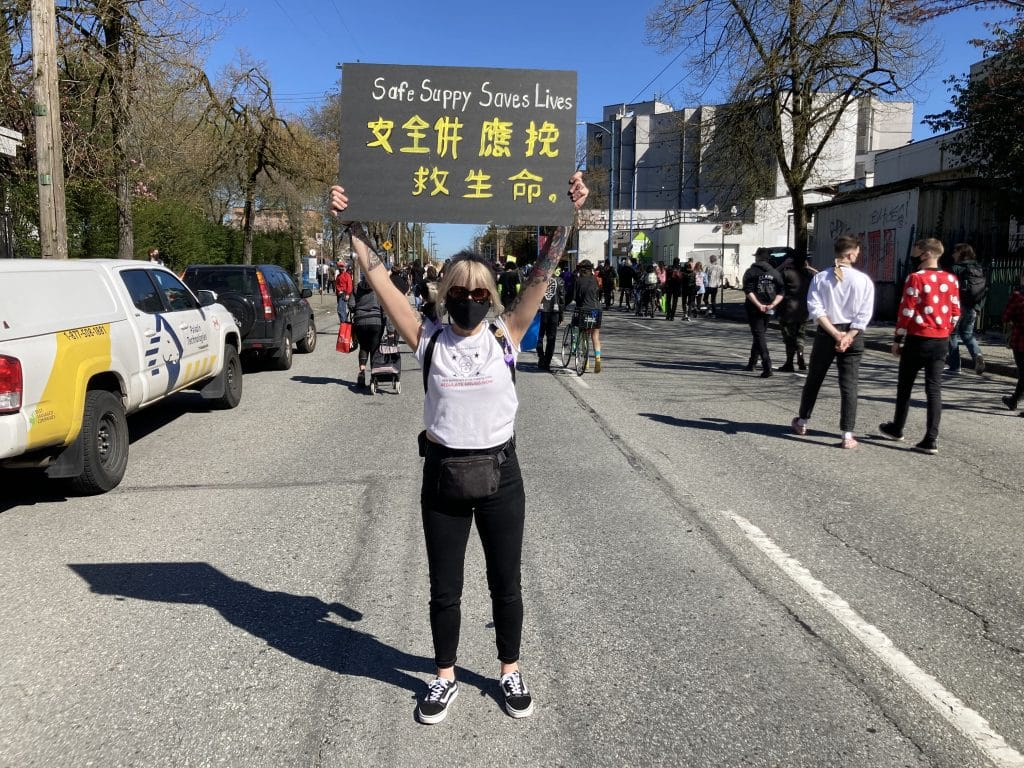 Protester at safe supply rally in Vancouver