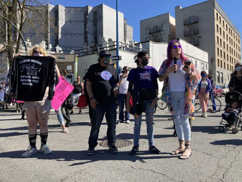Protesters and supporters at safe supply rally in Vancouver