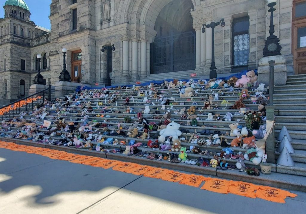 Childrens shoes and teddy bears on the steps of the Legislature in Victoria, BC