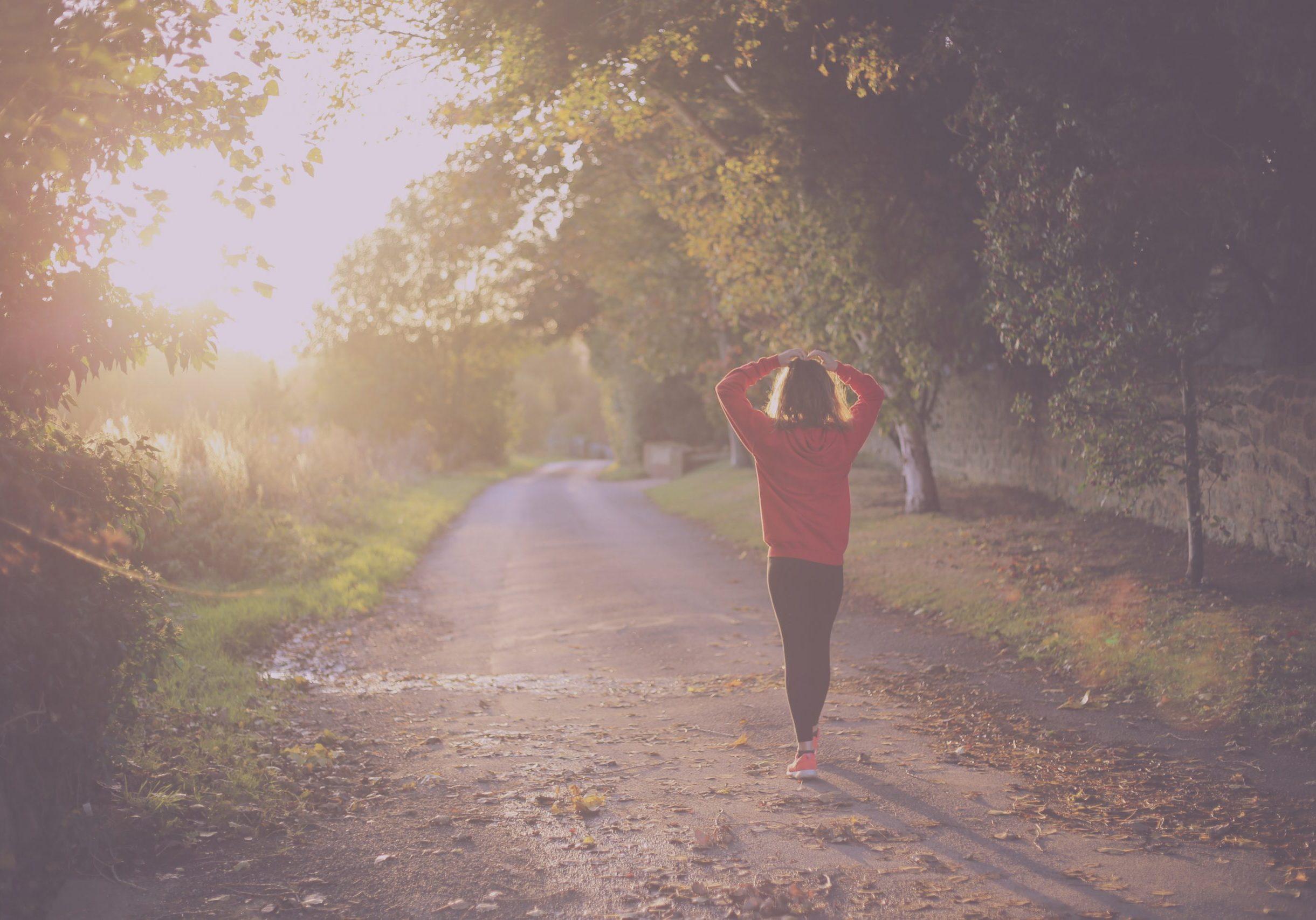 Woman walking down a trail